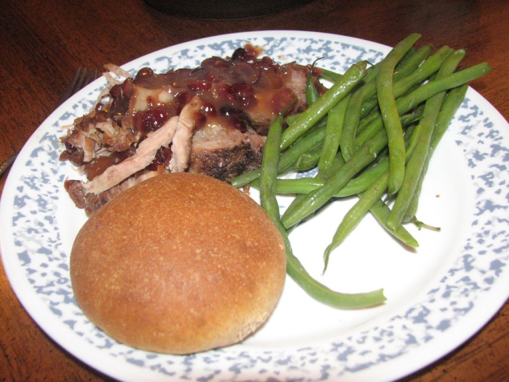 Cranberry-Orange Pork Roast with green beans and homemade yeast rolls.